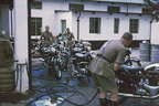 1965 Cleaning motorcycles at Cranborne Driving School after a cross-country ride