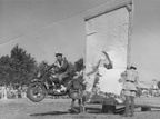 1950 Police Display at Bulawayo 4526 Doug Almy performing a blind ramp jump on an Indian motorcycle